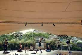 dancers warms up on stage under stretch tent at Hatch House