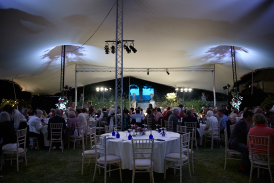 Diners under stretch tent at Hatch House