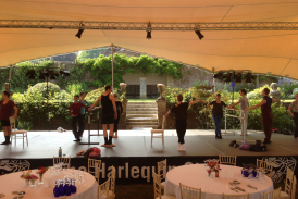 20m x 23m chino stretch tent at Hatch House. Dancers warm up on stage