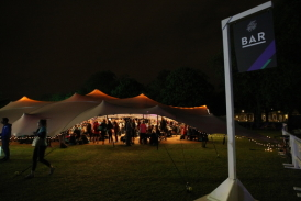 Bar stretch tent at Nike event, lit with festoon lights and fairy lights