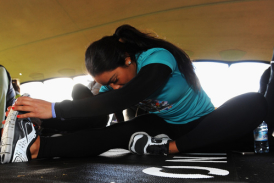 Athlete warms up in the 'Stretch Tent'