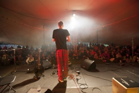Stretch tent acoustic stage at festival (Interior lit with GDS and MBI's)