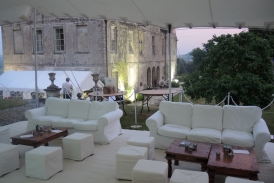 VIP area white sofas and low tables