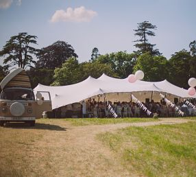 18m x 15m white stretch tent rigged open ended for a small wedding in Wiltshire